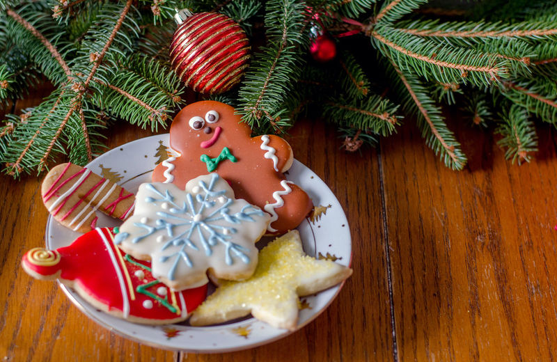 High Angle View Of Christmas Cookies In Plate On Table