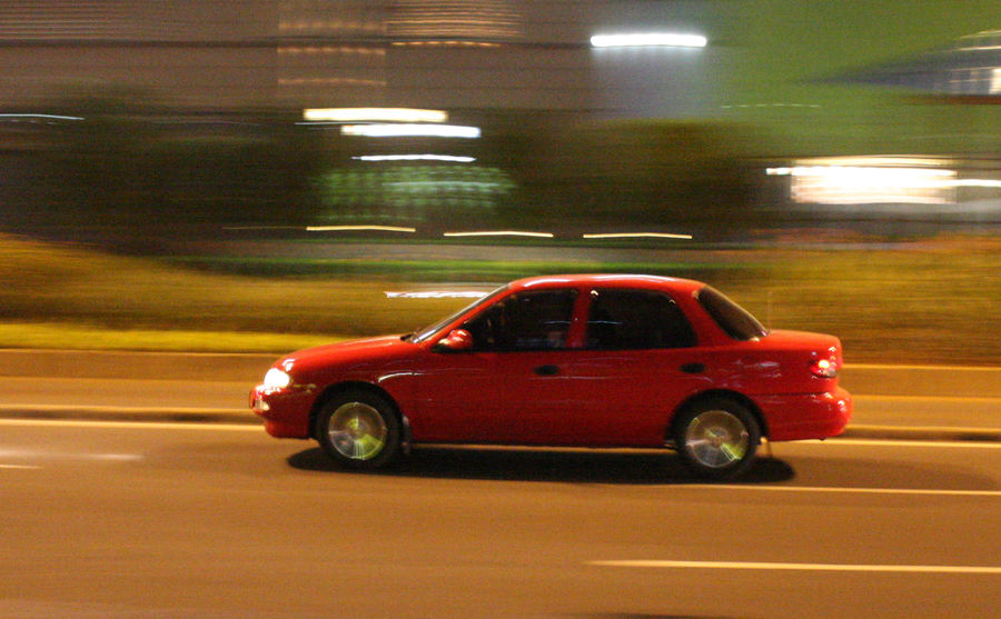 Panning Car Blurred Motion Car Illuminated Land Vehicle Long Exposure Mode Of Transport Motion Night No People Outdoors Red Road Speed Transportation