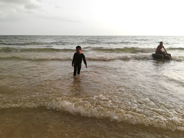 Children enjoy on summer trip 2019,หาดเจ้าหลาว Achi2019 Sea Water Horizon Horizon Over Water Sky Land Real People Beach Leisure Activity Motion Lifestyles Beauty In Nature Scenics - Nature Men Wave Nature People Vacations Day Outdoors