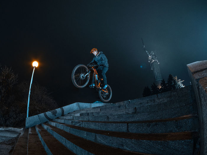 Man riding bicycle at night