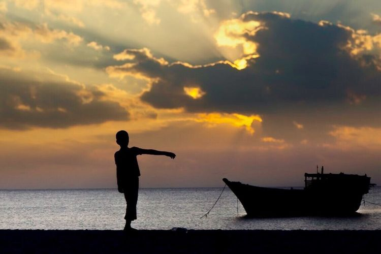 Unstable. Sunset Sea Silhouette Water Sky Cloud - Sky Beauty In Nature Nature Scenics One Person Nautical Vessel Horizon Over Water Real People Outdoors Transportation Beach Standing Men Day People