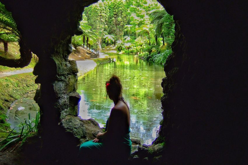 Real People Water Lifestyles One Person Rear View Nature Beauty In Nature Tree Leisure Activity Day Outdoors Low Section Mammal Cave Stone Lookingout Hole Nature Photography Scenics Azores EyeEm Nature Lover Garden Photography Thinking Outdoor Photography Natural