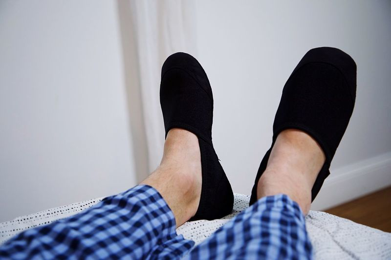 Slippers Low Section Human Leg Body Part Shoe Human Body Part Personal Perspective One Person Lifestyles Real People Human Foot Indoors  Limb Human Limb Relaxation Adult Leisure Activity Home Interior Sock Women Jeans