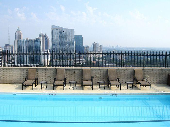Swimming pool against buildings in city