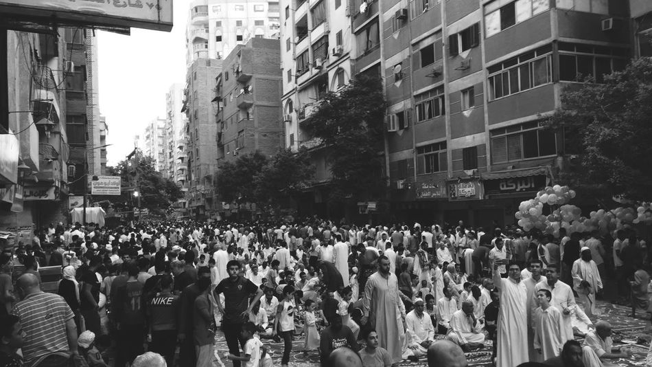 Crowd Large Group Of People Group Of People Architecture City Building Exterior A New Perspective On Life Street Real People Men Women Adult Day Residential District Outdoors Built Structure Leisure Activity City Life Lifestyles Celebration Building