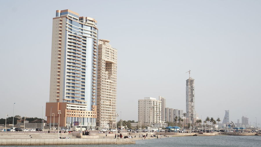 Modern Buildings In City Against Clear Sky