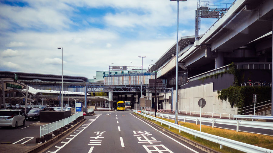 Atmosphere outside the airport in and car beautiful ASIA Architecture Business City Cityscape Japan Light Metro Road Rush Transport Transportation Travel View Building Car Japan Airport Japan Airport View Light And Shadow Motion Scene Sky Street Urban Vehicle