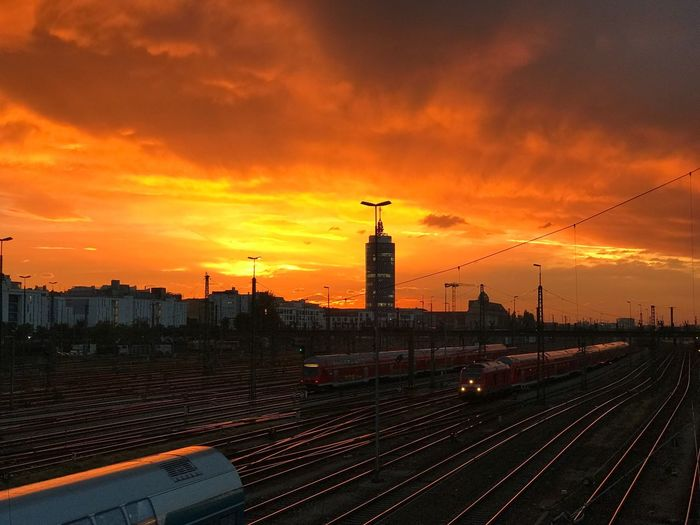 Sunset evening in Munich Architecture Built Structure Transportation Building Exterior Sky Motion Cloud - Sky City On The Move Travel Destinations Mode Of Transport Railroad Track Cloud Tall - High Urban Skyline Dramatic Sky Scenics Orange Color Outdoors Evening Redskyatnight RedSky