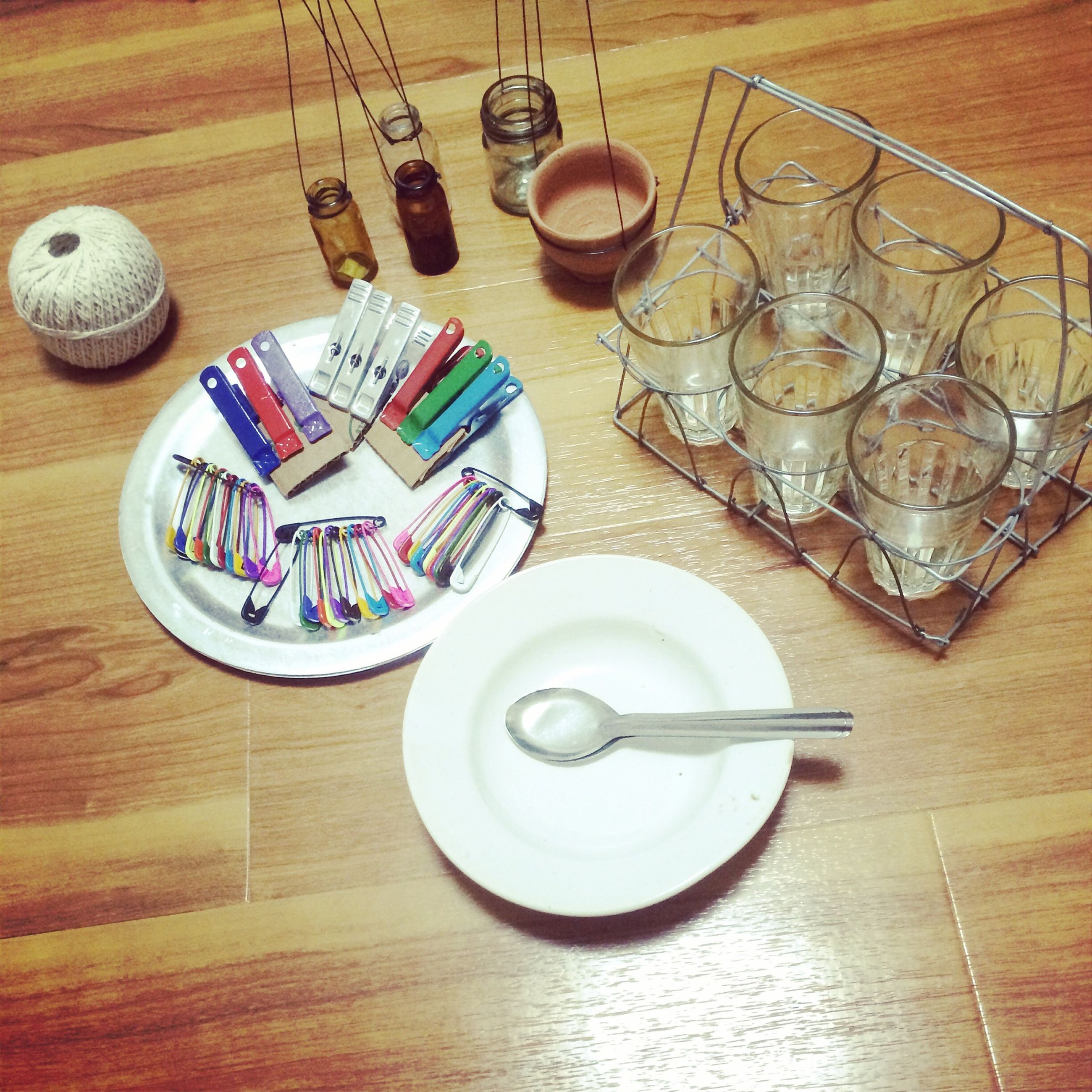 indoors, table, still life, high angle view, drink, wood - material, drinking glass, food and drink, glass - material, wineglass, no people, empty, refreshment, arrangement, close-up, home interior, spoon, plate, variation, bottle