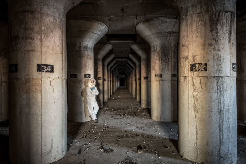 Man Wearing Bunny Suit In Abandoned Building