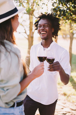 African Afro Celebration Couple Red Wine African Ethnicity Alcohol Black Cheers Drink Drinking Garden Party Smile Togetherness Wine