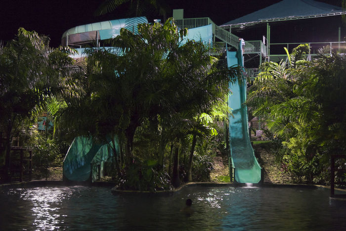 Tropical Spa with water slides - La Fortuna, Alajuela province, Costa Rica Costa Rica Freshness Illuminated Jacuzzi  Night No People Palm Tree Pond Pool Poolside Reflection Relax Relaxation Resort Slide Slides Spa Swimming Pool Tourism Tree Tropical Tropical Climate Water Water Slides Wellness