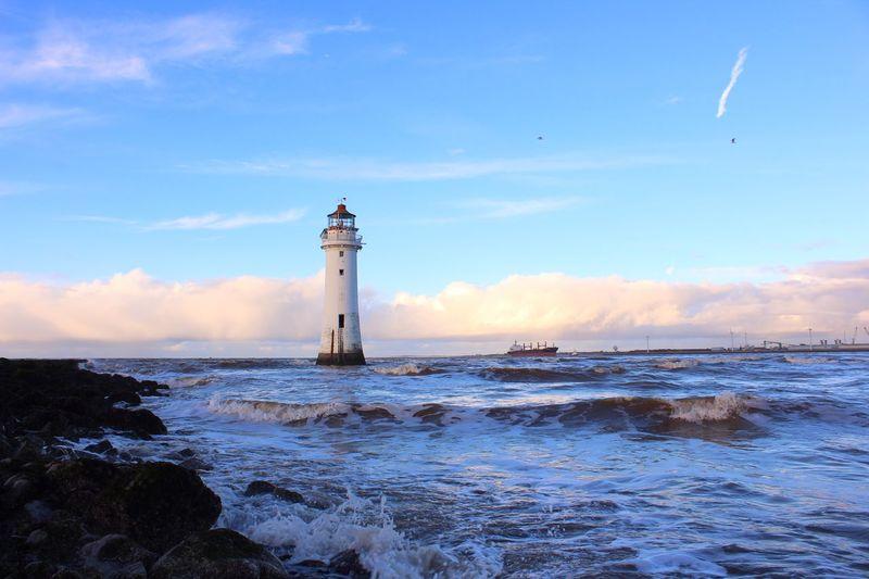 Lighthouse At Seaside