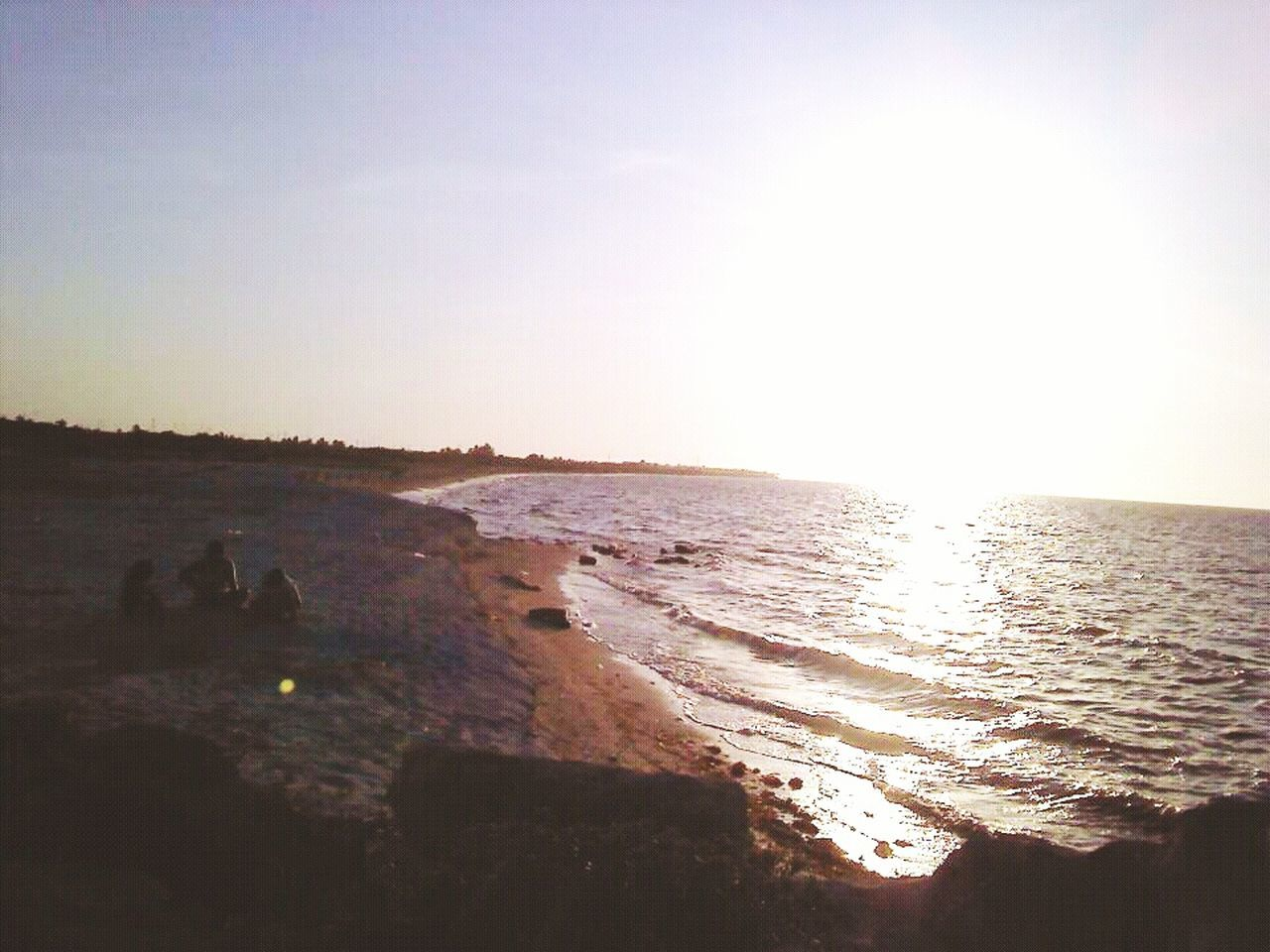 sea, water, nature, sunlight, beauty in nature, tranquil scene, sunset, scenics, clear sky, tranquility, beach, wave, outdoors, horizon over water, silhouette, no people, sky, day
