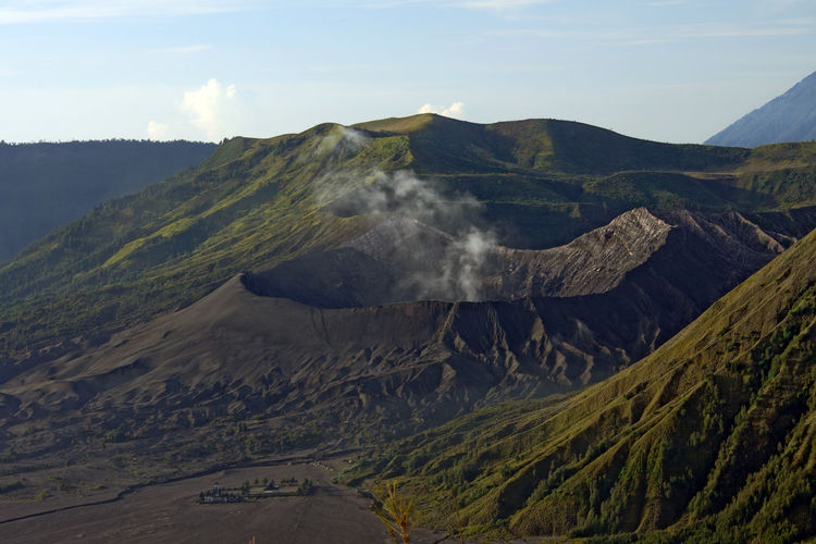 Smoke Emitting From Volcanic Crater Against Sky