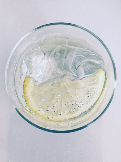 Soda Water Gassy Mineral Water Bubbly Water Bubbles Refreshment Cold Libations Lemon Wedge Fresh Ice Cubes Refreshment Household Equipment Drink Glass Drinking Glass Food And Drink Still Life Cold Temperature Table Close-up Studio Shot Directly Above Tonic Water Freshness