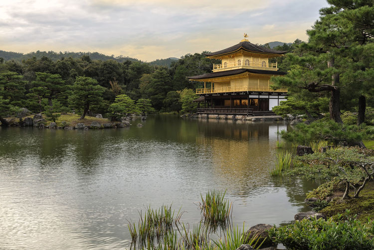 Kinkaku-ji Temple or Golden Pavilion during sunset, Kyoto, Japan Ancient Japan Architecture ASIA Buddhist Temple Evening Sky Famous Place Golden Pavilion  Historical Building Japan Kinkakuji Temple Kyoto Lake Landmark Landscape Nature No People Outdoors Place Of Worship Reflection Scenics Sky Sunset Travel Destinations Travel Photography Tree