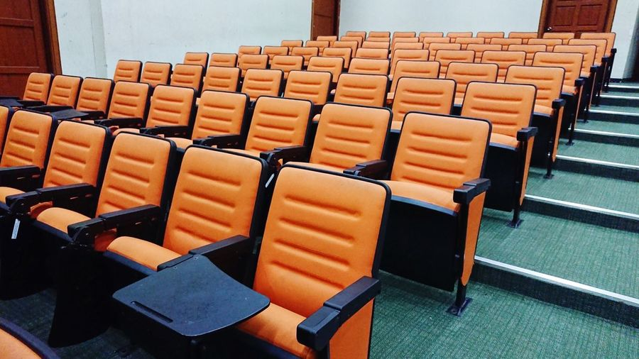 Chairs in a lecture room Orange Color Cinema Chairs EyeEm Selects Seminar Lecture Hall Auditorium Seat Chair Classroom Folding Chair In A Row Empty Education