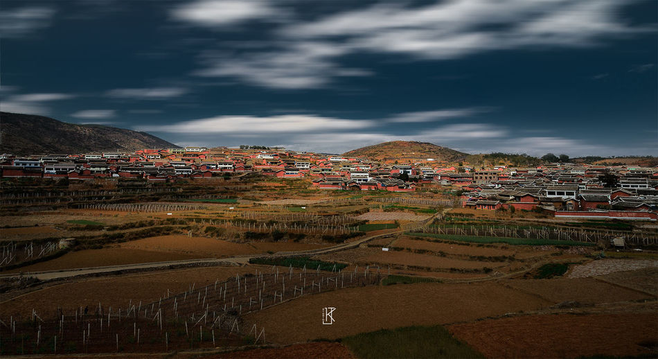 Chinese valley. City Mountain Cityscape Stadium Sky Mountain Range Landscape TOWNSCAPE Housing Settlement Depression - Land Feature Town Human Settlement Residential District Old Town