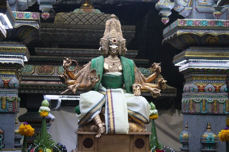 Low angle view of statues at mariamman temple