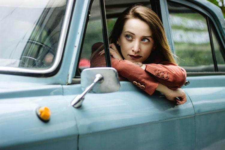 Portrait of beautiful woman in car