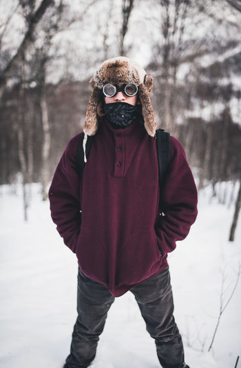 Portrait of a person standing on snow