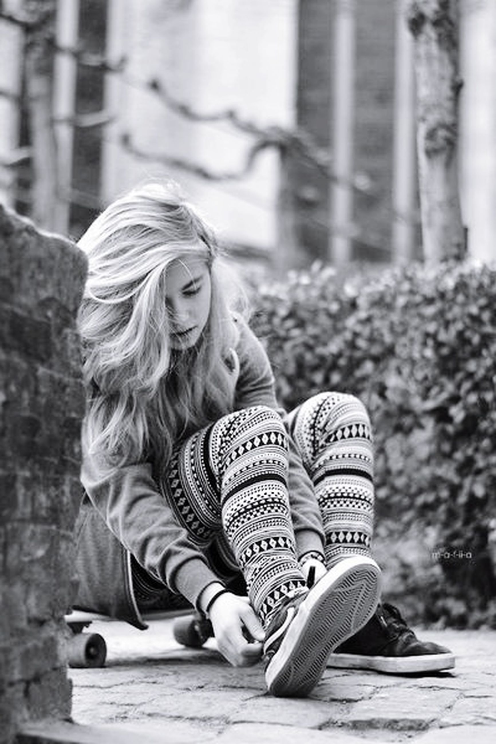 focus on foreground, person, lifestyles, casual clothing, childhood, leisure activity, elementary age, park - man made space, girls, long hair, full length, blond hair, tree, outdoors, front view, sitting, day, innocence