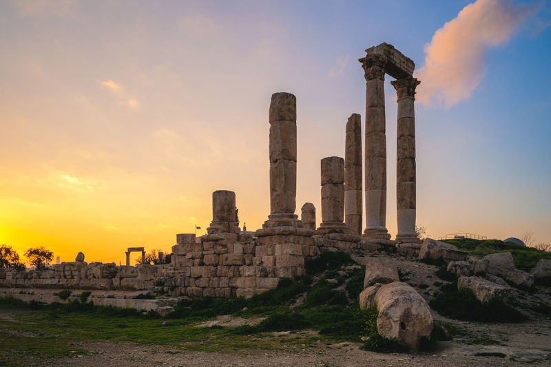 Ruins of temple against sky during sunset