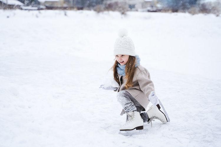 Full length of girl on snow covered field
