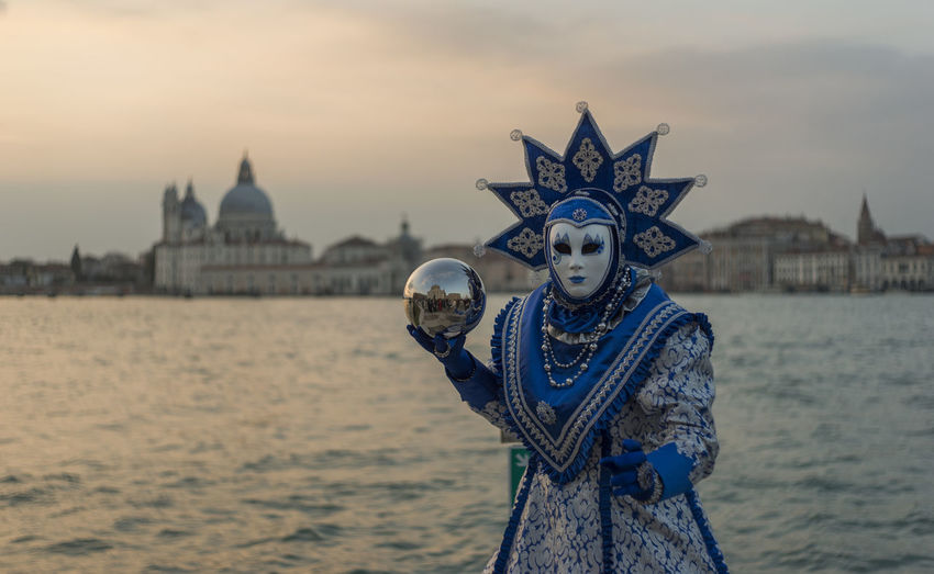 Carnival mask against sky during sunset venice