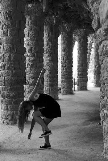 Woman dancing in corridor of old building