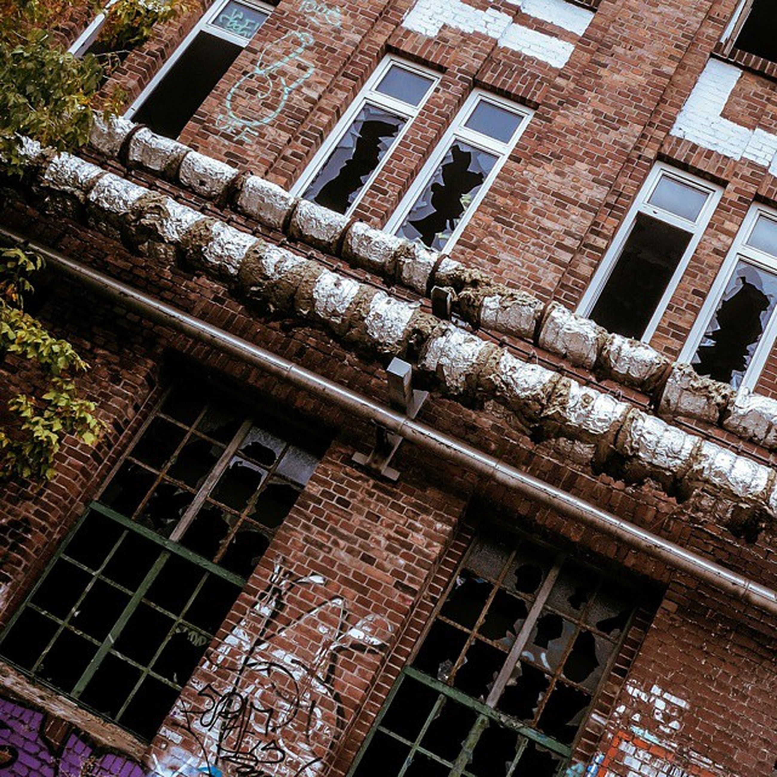 architecture, built structure, building exterior, window, low angle view, building, old, abandoned, residential building, damaged, residential structure, brick wall, weathered, day, outdoors, house, reflection, run-down, no people, full frame