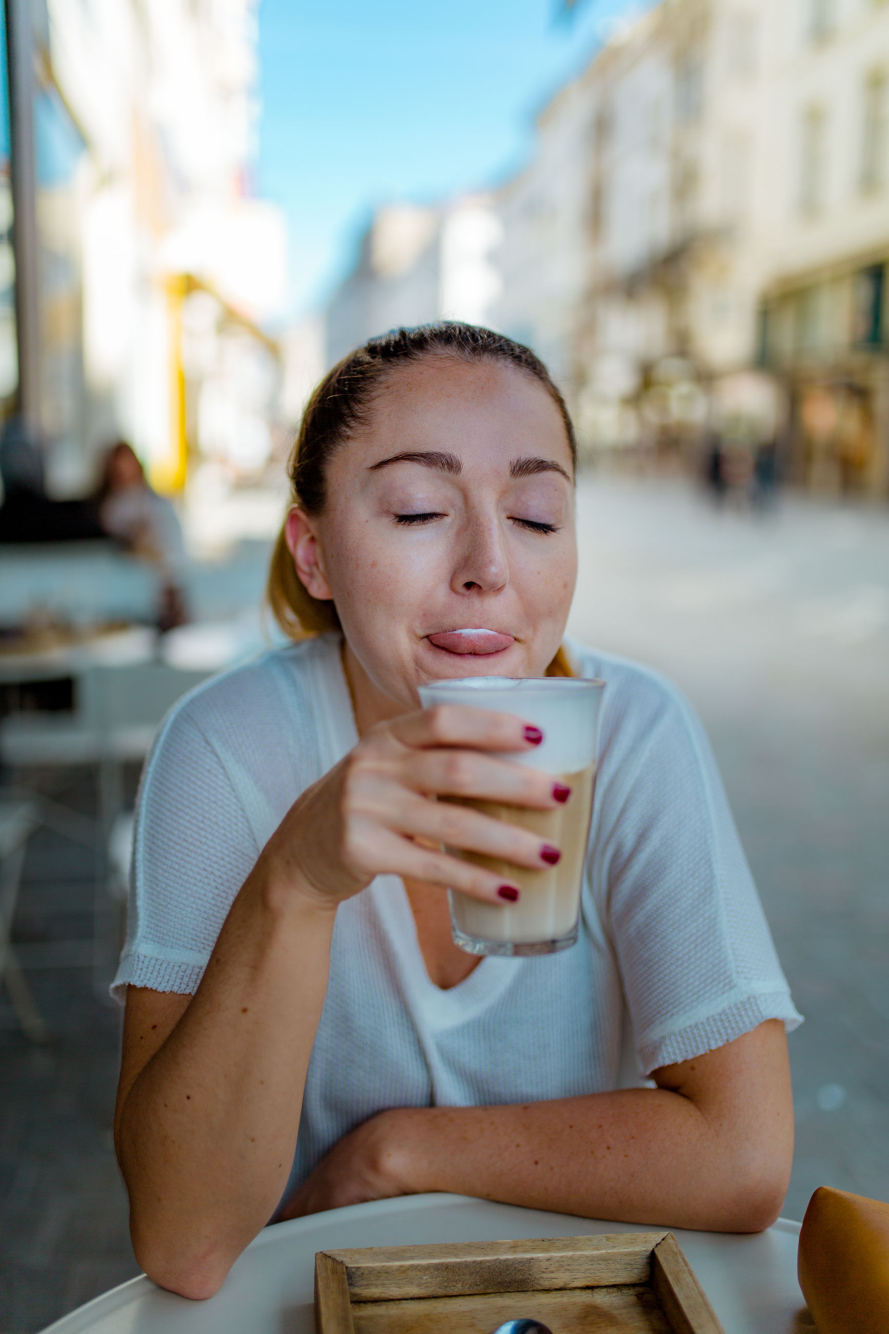 food and drink, drink, one person, refreshment, real people, coffee, focus on foreground, cup, coffee - drink, drinking, lifestyles, mug, young adult, coffee cup, front view, leisure activity, sitting, young women, table, glass