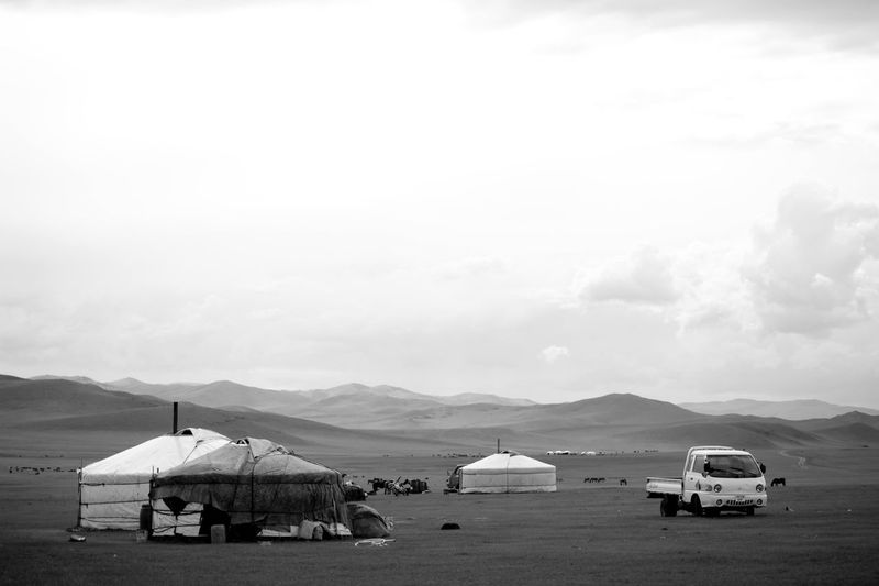 Mongolia Beauty In Nature Black And White Cloud - Sky Day Environment Land Land Vehicle Mode Of Transportation Mountain Mountain Range Nature No People Nomadic Nomadic Life Non-urban Scene Outdoors Scenics - Nature Sky Steppe Tranquil Scene Transportation Yurt Монгол улс гэр