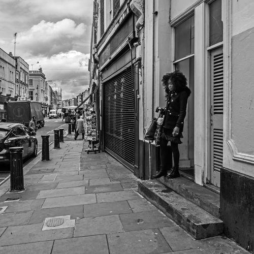 """Starting the day"" Architecture Black And White Blackandwhite Building Exterior Day Girl London Notting Hill Outdoors Person Portobello Market Sky Street Woman Women Around The World The Street Photographer - 2017 EyeEm Awards"