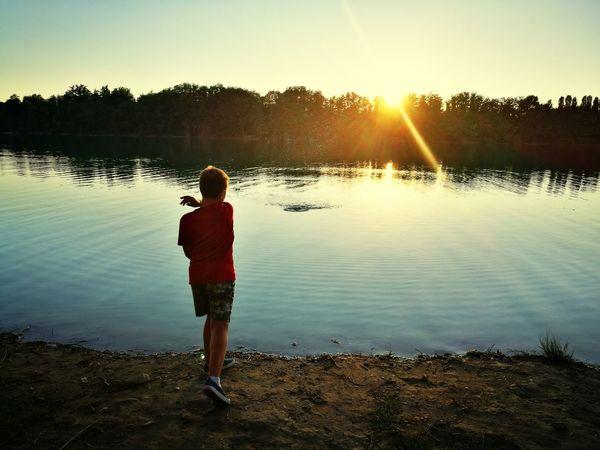 Water Full Length Child Men Sunset Boys Lake Summer Sunlight Standing
