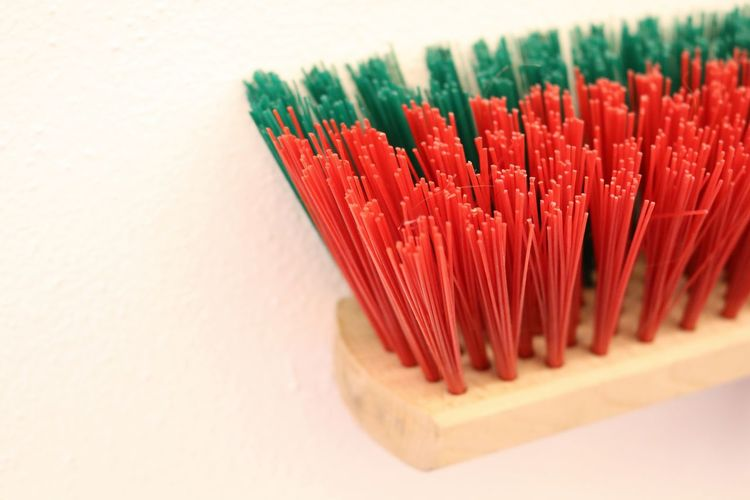 Close-up of colorful broom on white background