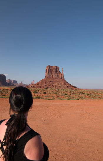 Rear View Of Woman Looking At East Mitten In Monument Valley
