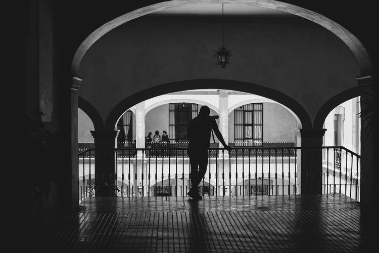 Arch Architecture Entrance Flooring Indoors  Person Reflection Silhouette Walking Monochrome Photography