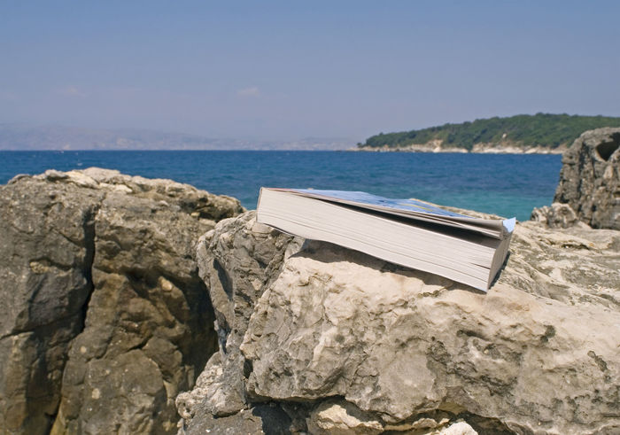 book abandoned on rocks, Greece Reading Travel Vacations Abandoned Beach Book, Close-up Coast Coastal Day Landscape Left Behind Leftbehind No People Novel Object Outdoors Relaxation Rock - Object Rocks Scenics Sea Sky Stone Material Summer