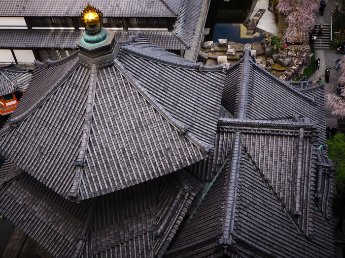 High angle view of illuminated roof and building in city