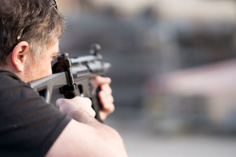 Man Aiming With Gun