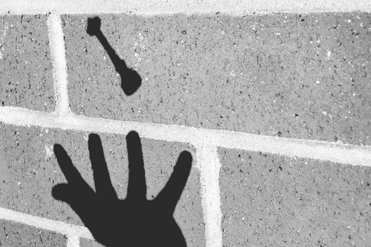 Levitating shadows Human Hand Close-up Shutter Fast Spaceneedle Levitation Photography Levitation Floating Float Magic Souvenirs Souvenir Human Finger Shadow One Person Outdoors Brick Wall Blackandwhite Nocolor Human Body Part Hand Shadows & Lights POV Creativity Creative Light And Shadow