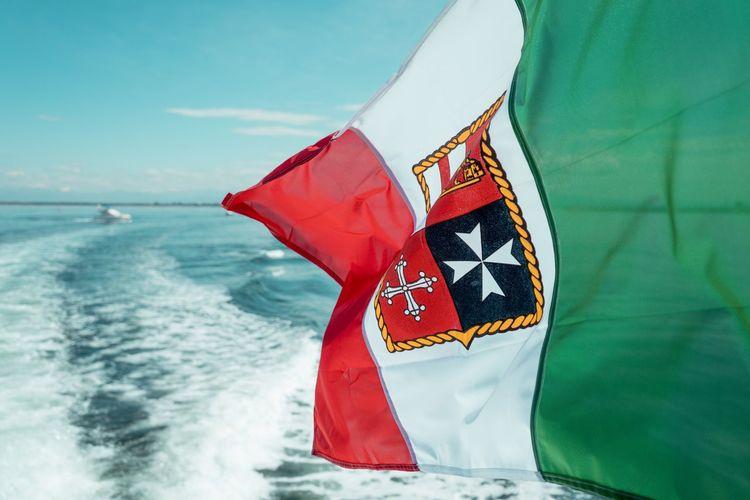 Flag waving against sea