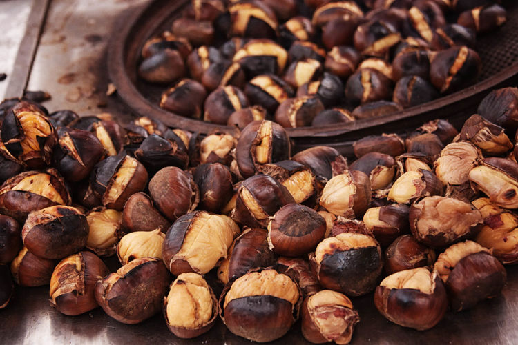 Roasting Chestnuts Abundance Autumn, Background, Backgrounds, Black, Bright, Brown, Cafe, Chestnut, Chestnuts, Closeup, Color, Colorful, Cooking, Cuisine, Culture, Delicious, Dessert, Diet, Dinner, Eating, Fall, Fire, Food, Fruit, Group, Macro, Market, Nature, Nut, Objects, Open, Out Brown Chestnuts Close-up Freshness Large Group Of Objects No People Roasted Coffee Bean Selective Focus Still Life