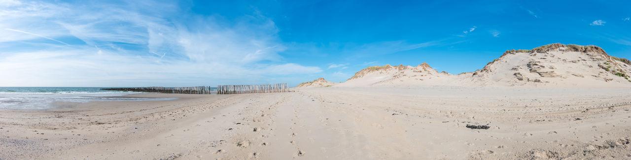 Sand dunes at the beach in Zeeland panorama Baltic Sea Dunes Nature Netherlands Panorama Panoramic View Wave Beach Beauty In Nature Blue Sky Breakwater Day Groyne Horizon Over Water Northsea Ocean Outdoors Sand Sand Dune Scenics Sea Shore Summer Wave Breakers Zeeland