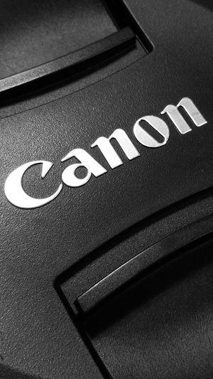 Text Indoors  No People Close-up Canon Camera Lens Lenscap