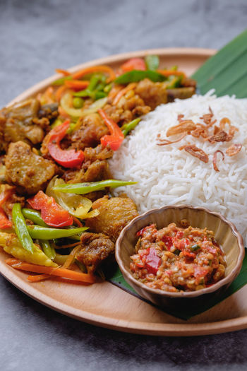 Nasi Ayam Kunyit Food And Drink Food Ready-to-eat Indoors  Meat Vegetable Freshness Healthy Eating Table Plate Close-up Rice - Food Staple Serving Size Still Life No People Bowl Bell Pepper Pepper Wellbeing Onion Crockery Dinner Nasi Ayam Kunyit Malaysian Food
