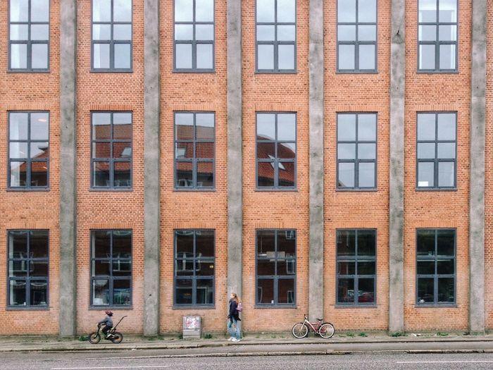 Boy on cycle, woman, cycle. Aarhus, Denmark. Cycles Aarhus Denmark