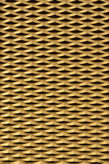 Golden background from sheet metal with pattern Golden Background Gold Griddle Griddle Pan Metal Textured Effect Abstract Backgrounds Full Frame Pattern No People Repetition Indoors  Yellow Textured  Wall - Building Feature Close-up In A Row Built Structure Architecture Brown Abundance Design Curve Large Group Of Objects